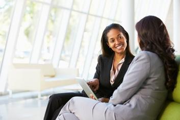 two-businesswomen-talking